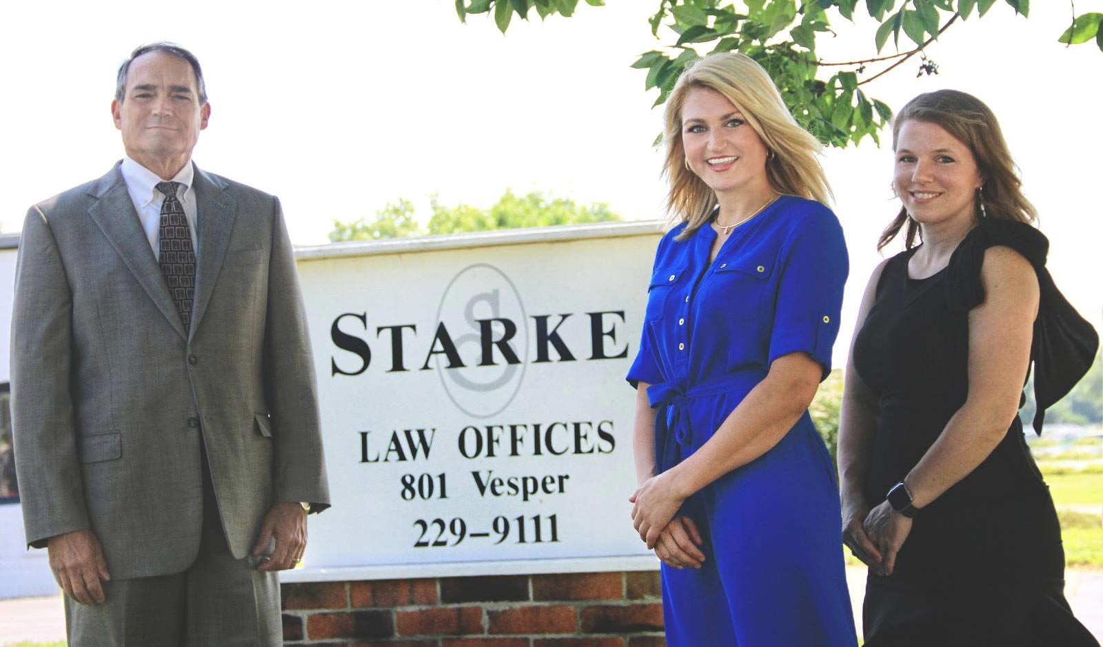 Starke Law Offices staff in front of their office building